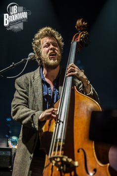 Ted Dwane of Mumford & Sons performs at San Manuel Amphitheatre in San Bernadino, CA on June 2, 2013. Photo © JB Brookman.