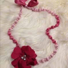 Pink Stella & Dot necklace  PRICE DROP This necklace is so beautiful. The flower can be moved anywhere on the cloth chain or can be used as a hair bow or a pin to wear on something else. It also ties in the back so it will can be made any length that you choose  Stella & Dot Jewelry Necklaces