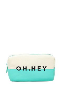 """Oh, Hey Makeup Pouch $6.90  Hey girl hey! Store your makeup essentials in this colorblocked pouch, and you'll look glam no matter where the day takes you. It features a """"Oh, Hey"""" graphic and a top zipper. Flawless makeup, here you come.  Fully lined, woven Self: 100% cotton; Lining: 100% polyester 4"""" height x 9"""" width x 4"""" depth"""
