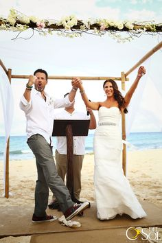 Fantastic bride and groom on the beach at a destination wedding in Mexico, groom is stylin' in his @Converse ! #converse Wedding photographers in the Riviera Maya Del Sol Photography #celebration #fistpump