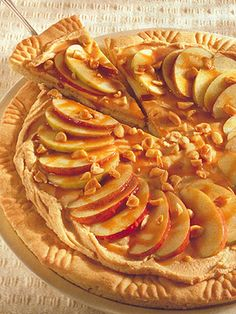The peanut butter and cream cheese combo spread over a sugar cookie crust provides a tasty foundation for the thinly sliced apples and a drizzle of caramel ice cream topping.