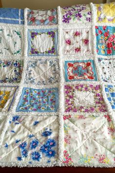 """Turn vintage hankies into a rag quilt.  Create a darling rag quilt from beautiful old hankies. Cut pieces of flannel and fleece squares to back each hanky, then sew blocks of hankies together in a row, leaving a one-inch wide seam between each block. Snip perpendicular to the seams between each block to create the traditional """"rag"""" style."""
