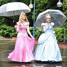 There is some thing elegant about the Disney princesses with umbrellas!