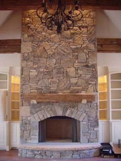 You could still do the front in all stone and then the other 3 sides wood… – Stone fireplace living room Rock Fireplaces, Rustic Fireplaces, Farmhouse Fireplace, Fireplace Hearth, Home Fireplace, Fireplace Remodel, Fireplace Surrounds, Fireplace Stone, Fireplace Makeovers
