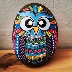 Hand painted stone Owl design by ShePaintsSeaStones on Etsy