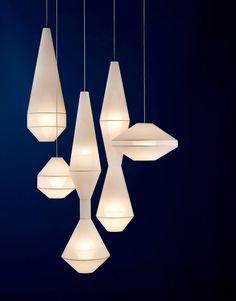 Coco Flip's new 'Mayu' pendant lights in geometric shapes in translucent cloth.