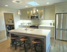 A Fine Design designed this elegant kitchen in Toronto, featuring a Formica®180fx® Travertine Silver island.