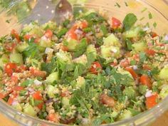 TABBOULEH - Ellie Krieger (Use the full amount of parsley.  I use an entire small container of grape tomatoes.  Make in the morning so that it has time for the flavor to meld.  After the bulgar sits for the recommended 15 min., it will seem a bit toothy, but after the salad has sat in the refrigerator all day it will be perfect.)