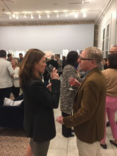 Guests enjoying the art and conversation at the annual Private Collections post-party celebration.