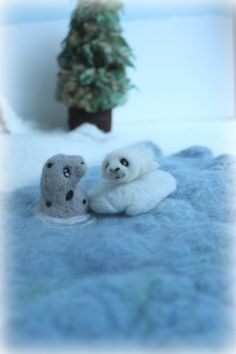 Needle felted mama and baby seal from a winter playscape