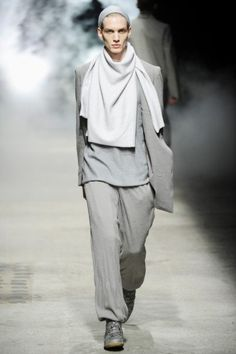 Damir Doma Menswear. I adore the use of monochromatic greys and the subtle shift in tone from the garments to the scarf. Again the idea of layering is highlighted by the use of slightly differing shades as it creates a focus on tonal depth and shading.
