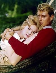 One of today's birthday celebrants, Connie Stevens with co-star Troy Donahue in the film Susan Slade (1961) - these 2 were all over the movie magazines when they were on Hawaiian Eye together - they were a hot couple in teen eyes then.
