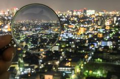 Magnifying Glass Reveals In-Focus Tokyo Among a Dazzling Blurred Landscape - My Modern Met