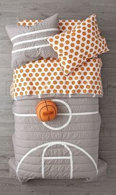 Our Nod Basketball Bedding is so great, it's ready to go pro. Made comfy cotton, the grey quilt is uniquely designed to resemble a basketball court. And the patterned basketball sheets are made from organic cotton.