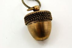 """oh sweet, it's a kiss... remember, from Peter Pan!! love....Acorn necklace"" Love this!"