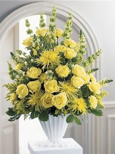 This is a gorgeous arrangement featuring yellow roses, mum's, and solidago golden ray flowers. Honor your loved ones bright spirit with this beautiful arrangement. Flowers Included: Roses: 6 Mum: 6 Solidago: 5 Also Included: Vase & Greenery Altar Flowers, Church Flowers, Funeral Flowers, Bright Flowers, Fresh Flowers, Yellow Flowers, Beautiful Flowers, Yellow Flower Arrangements, Funeral Floral Arrangements