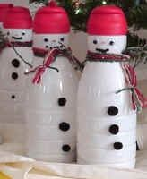 Coffee creamer bottles made into snowmen filled with candy.