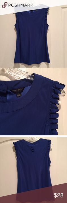 Banana Republic Royal Blue Sleeveless Blouse tiny spot in the bottom right corner - barely noticeable and I haven't tried to treat it. Very hard to see. Banana Republic Tops Blouses