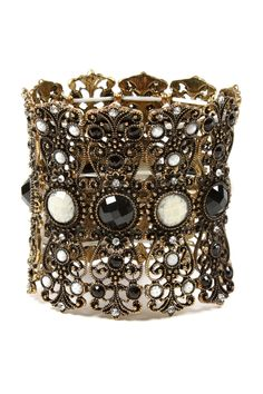 Antique gold-tone filigree cuff with faceted white jade and jet black stones & Austrian crystal accents