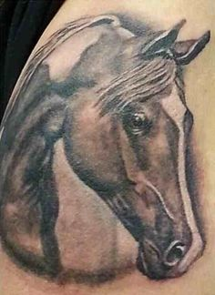 Paint, pinto horse tattoo ..... I wanna get one of Finey and Darlin