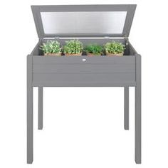 Protect your seedlings with this cold greenhouse, a stylish addition to your patio or balcony.   Product: GreenhouseConstruction Material: PinewoodColour: GreyFeatures:  Farm folklore styleHigh standard finishDimensions: 101 cm H x 90 cm W x 51 cm D