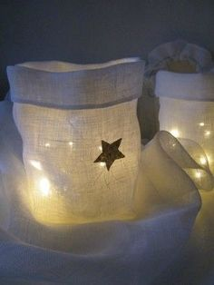 White hessian or linen lumière - for next Christmas. (twinkle / string lights or similar only. Linen and hessian are too flammable for real flame candles)