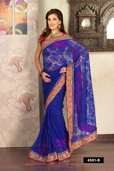 Blue net saree with silver heavy embroidery comes with pink Dupion blouse