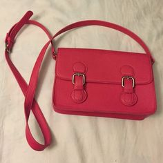 F21 Pink Crossbody Purse I've only used it once for a beach purse. I wore it to Santa Cruz Boardwalk once. It was perfect use for one day outfit. There are minor stains. I don't know how to clean it off. It was hanging w/ colored bags and I guess it rubbed off another handbag :( Forever 21 Bags Crossbody Bags