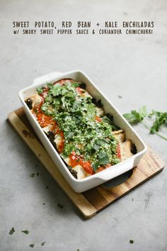 Sweet Potato, Red Bean + Kale Enchiladas w/ Smoky Sweet Pepper Sauce & Coriander Chimichurri | Veggie num num @sallyabout  thinking I might try this in May? :)