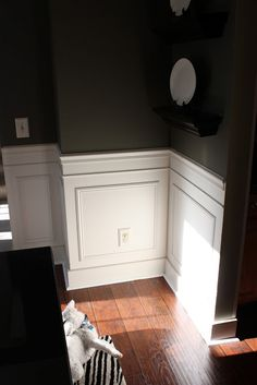 Install picture frame molding. See also http://southernhospitalityblog.com/how-to-install-picture-frame-molding/