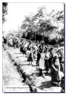 Jews being led to Babi Yar. Kiev. September 1941. They will be made to strip down and then lined up and shot I to a pit where others already shot and killed