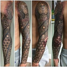 I do not like the face on the shoulder of this tattoo, but I like the way the tattoo swirls around the arm with a variety of shapes and textures.