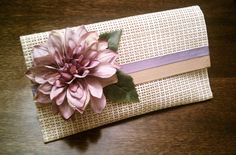 My girlfriends and I have been getting crafty, using something as simple as a placemat to create these darling clutches. All you need are: placemats duct tape (it comes in l. Diy Clutch, Diy Purse, Clutch Purse, Diy Bags Purses, Bridal Clutch, Giant Flowers, Diy Handbag, Craft Bags, Beaded Bags