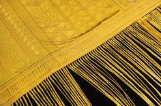 Golden Silk Made by 1 Million Spiders: This cloth was made from the silk of golden orb spiders collected from telephone posts in Madagascar by 70 people over a period of 4 years.