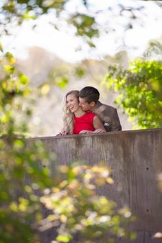 Too-cute couple moment from a gorgeous autumn engagement | Image by Matthew Moore Photography