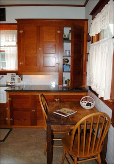 C. 1915 Kitchen with Douglas Fir Cabinets by American Vintage Home, via Flickr