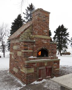 Julie M. of Iowa shared this stately Forno Bravo Professionale110 build with us for our Winter Photo Contest. #Pizzaovens #Winterfire