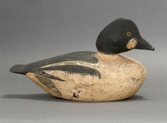 GOLDENEYE DRAKE DECOY First Quarter of the 20th Century <br /> From Cohasset, Massachusetts. Maker unknown. Tack eyes. Original paint with wear.