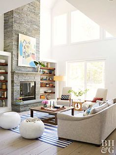 Stacked stone is an ideal material to use for remodeling a dated fireplace, such as this renovated beauty that emphasizes the room's soaring ceiling. Thin slices of real stone cover the old materials and are lightweight to make installation easier.