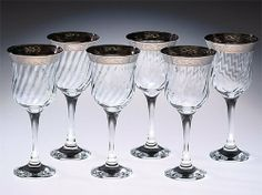 """Lorenzo Import 24-CM Set Of 6 Wine Glasses Thick Silver Border by Lorenzo Import. $35.49. Great Gift Idea.. Design is stylish and innovative. Satisfaction Ensured.. Manufactured to the Highest Quality Available.. Dress up your table with these fabulous set of 6 flute glasses featuring a thick silver border and a stemmed bottom. Made in Italy. Glasses are 7"""" tall and hold 6 ounces."""