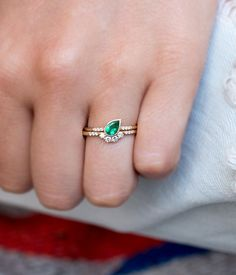 We want our stacks to feel like they were meant to be. This one is no exception! The beautiful tear-drop shape of the emerald in the Diamond Arch Ring. The resulting stack is flawless, sparkly, and ef