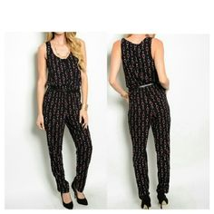 Ladies Jumpsuit New Size:  Small  Medium(choose your size) Color: Black Magenta White Gray Material:  Polyester Details:  All over graphic print,  front scoop neckline,  top front has buttons to the waist,  comes with a belt, elastic waistline,  straight leg pants Pants Jumpsuits & Rompers