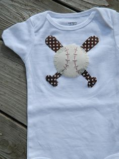 Baseball Onesie, Baseball Shirt, Baseball first Birthday Outfit, Boy or Girl Baseball Onesie, New Born Photo Outfit, Baby Shower Decor, Baby. $19.95, via Etsy.