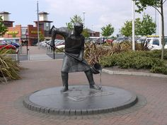 The statue of a foundryman on the former Leyland Bus Factory (now Morrisons) in Leyland, Lancashire UK
