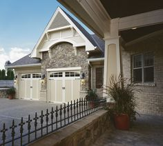 #Garagedoor4less COACHMAN® collection Authentic carriage house style garage doors constructed with durable insulated steel and composite overlays. www.garagedoor4less.com