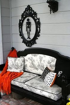 "A previous pinner said:    ""cheap ornate frame, spray painted with skeleton inside. how cute and cheap! ""  But I like the black furniture with the black toile upholstery---that couch is a bed converted to a bench!"