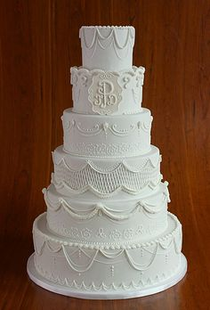 Ambiance~Distinctive Weddings & Events A Traditional, Six-Tier Wedding Cake  Photo C/O brides.com  (410 819-0046