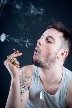 Polish soldier having fun with smoke.  Bartłomiej Kopczyński Black Studio portrait Photography www.blackstudio.eu