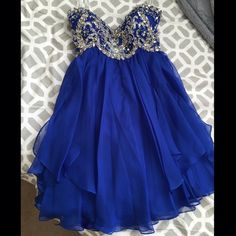 SHERRI HILL PROM DRESS Royal blue with beautiful embellishment on the bust and back, zips up in the back--worn once to my junior formal and is in perfect condition. Was size 6 taken in to be a 2. (That's why the tag in the picture says 6) originally $318 Sherri Hill Dresses Prom