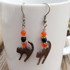 Hey, I found this really awesome Etsy listing at https://www.etsy.com/il-en/listing/249437517/halloween-black-cat-earrings-with-orange